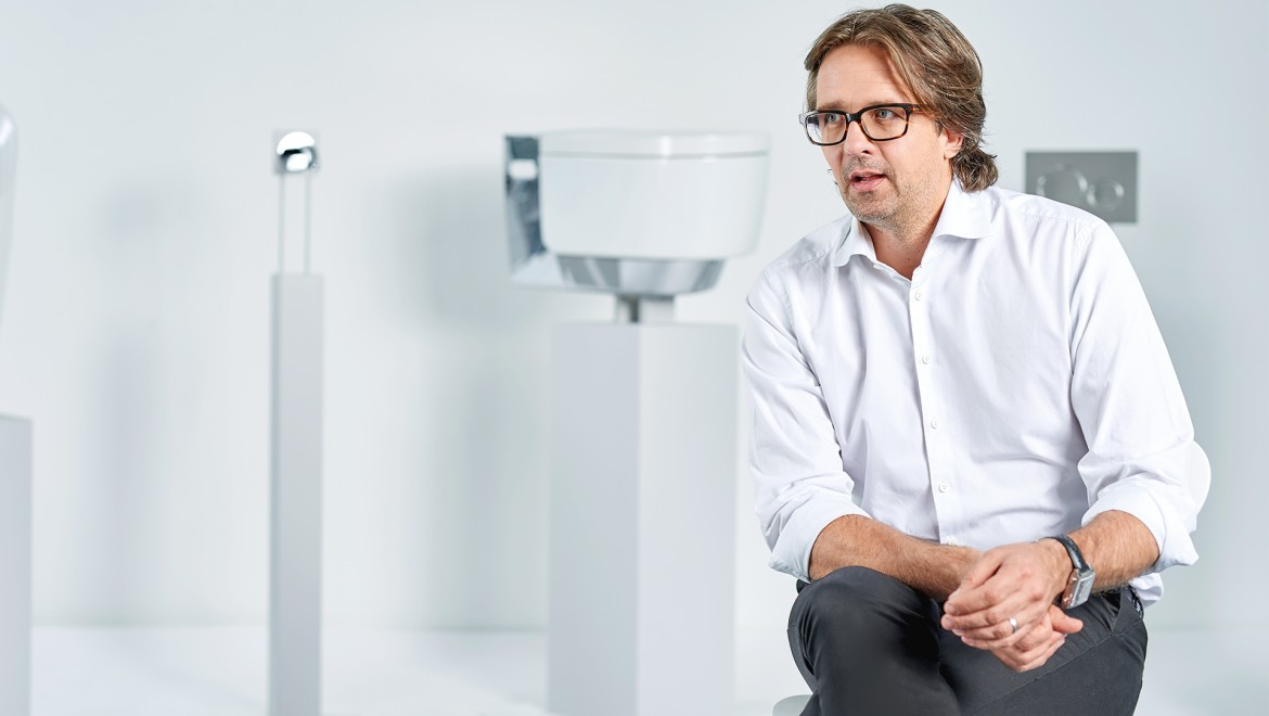 Christoph Behling in front of the Geberit AquaClean Mera